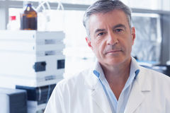 Portrait of an unsmiling scientist wearing lab coat Royalty Free Stock Photography