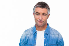 Portrait of a unsure man in casual clothes Stock Photos
