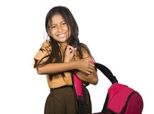 Portrait of upset and beautiful female child carrying heavy school bag full of textbooks and homework struggling upset and unhappy. In student material royalty free stock image