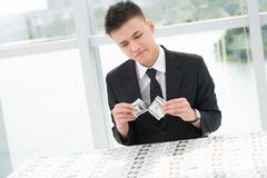 Inflation. Portrait of an upset businessman tearing money Stock Images