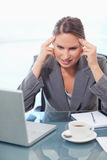 Portrait of an upset businesswoman having a headache Royalty Free Stock Images