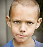 Portrait of upset handsome boy Stock Photos