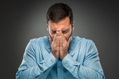Portrait of upset man covering his face by hands Stock Images