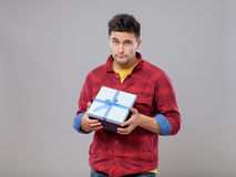 Portrait of upset man with gift Stock Photography