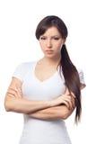 Portrait of upset woman against white background Stock Photos