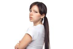 Portrait of upset woman against white background Stock Image