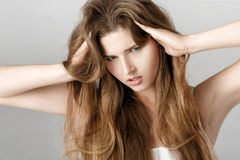 Portrait of upset woman with long hair. hopelessness or headache Royalty Free Stock Photography