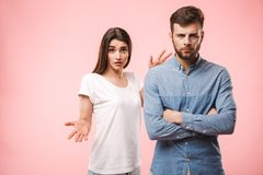 Portrait of an upset young couple having an argument stock images