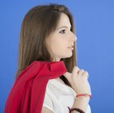 Portrait of urban business woman wearing tie, isolated on blue Royalty Free Stock Photo