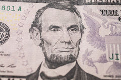 Portrait of US President Abraham Lincoln on the five dollar bil Stock Images