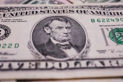 Portrait of US President Abraham Lincoln on the five dollar bill Royalty Free Stock Image