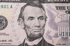 Portrait of US President Abraham Lincoln on the five dollar bill. Background of the money, five dollar bills front side obverse. background of dollars, close stock photography