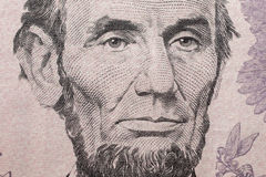Portrait of US President Abraham Lincoln on the five dollar bill Stock Photo