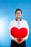 Portrait of valentine romantic happy man showing his love place Stock Photos