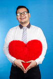 Portrait of valentine romantic happy man showing his love place Royalty Free Stock Image