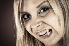 Portrait of a vampire with fangs Stock Image