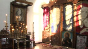 Portrait of Vanga and the iconostasis in the church of St. Petka in Rupite, Bulgaria stock video
