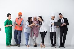 Portrait of various professions with modern technology royalty free stock image
