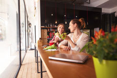 Portrait of vegeratian ladies in cafe Royalty Free Stock Photography