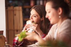 Portrait of vegeratian ladies in cafe Royalty Free Stock Images