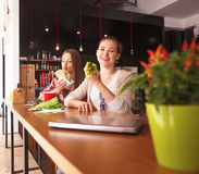 Portrait of vegeratian ladies in cafe Royalty Free Stock Photo
