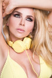 Portrait of a very beautiful blond hair woman in sexy outfit with headphones Stock Photo