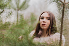 Portrait of a very beautiful girl in a forest dressed in fur Stock Photography