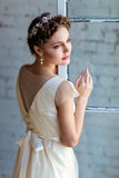 Portrait of a very beautiful sensual girl in a white dress stand Stock Photo