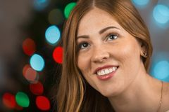 Portrait of a very beautiful smiling young woman. Female face closeup Stock Photo
