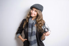 Young woman with retro film camera. Royalty Free Stock Photography