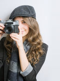 Young woman with retro film camera. Stock Images