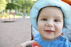 Portrait very happy baby in hat. Portrait very happy baby in blue hat Stock Photo