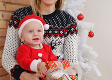 Portrait of very happy cute little baby boy in Santa suit with g Stock Photo