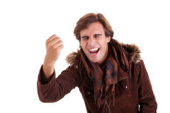 Portrait of a very happy  man with his arm raised Royalty Free Stock Photo