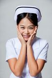 Portrait of  very happy young Asian nurse Stock Photo