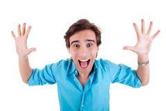 Portrait of a very happy young man with his arms r Royalty Free Stock Photo