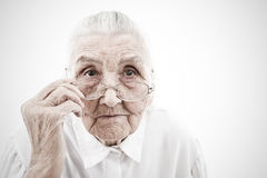 Grandmother with glasses. Portrait of a very old women taking off  her glasses Stock Images