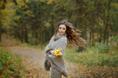 Portrait of a very pretty, smiling girl in a knit sweater, hair royalty free stock image
