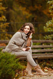 Portrait of a very pretty, smiling girl in a knit sweater, with stock photography