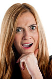 Portrait of a very shocked looking woman Stock Images