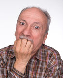 Portrait of a very surprised elderly men Royalty Free Stock Photography