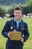 Portrait Of Vet In Field With Sheep In Background. Vet In Field With Sheep In Background Stock Photos