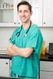 Portrait Of Vet Wearing Scrubs In Surgery. Vet Wearing Scrubs In Surgery Stock Image