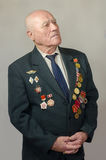 Portrait of a veteran of the Great Patriotic War. On a gray background Stock Photo