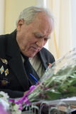 Portrait of a veteran of the Great Patriotic War. World War II veteran, wrote at the table Royalty Free Stock Photos