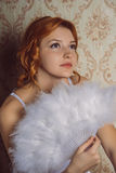 Portrait Victorian redhair woman with white feather fan.  Stock Image