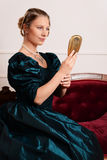 Portrait victorian woman with mirror Royalty Free Stock Photo