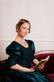 Portrait victorian woman reading book Royalty Free Stock Photography