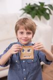 Portrait view of child boy sitting at home. Royalty Free Stock Photos