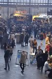 Portrait view of the East end of the Foodfestival. Amsterdam, the Netherlands - November 29, 2015: Visitors and the Bruschetta food truck in the Europe Complex ( Royalty Free Stock Image